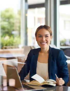 asian-businesswoman-working-at-cafe-YFEPWLB.jpg